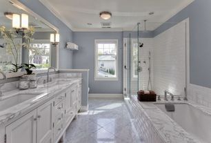 Traditional Master Bathroom with Master bathroom, Cylinder glass bath sconce, Inset cabinets, Standard height, flush light