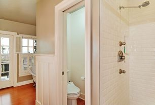 Traditional Master Bathroom with Rain shower, Laminate floors, Master bathroom, Clawfoot, French doors, Wainscotting