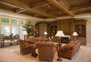 Mediterranean Living Room with Interlocking Pavers, picture window, Standard height, Exposed beam, Built-in bookshelf