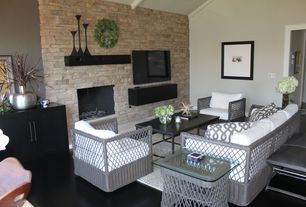 Contemporary Family Room with Laminate floors, stone fireplace, Fireplace, Standard height