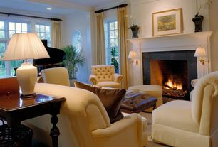 Traditional Living Room with brick fireplace, can lights, double-hung window, Standard height, Fireplace, specialty window