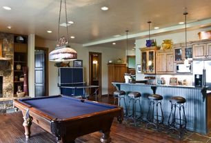 Eclectic Game Room with six panel door, Pendant light, Built-in bookshelf, Standard height, can lights, flush light