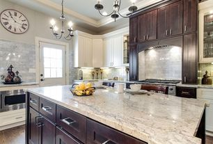 Traditional Kitchen with Breakfast bar, Chandelier, Large Ceramic Tile, built-in microwave, Framed Partial Panel, Glass panel