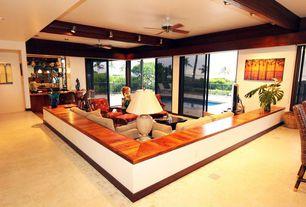 Modern Living Room with Sunken living room, MS International Florence Beige Porcelain Tile, Exposed beam, Ceiling fan, Carpet