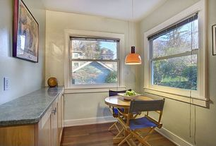 Cottage Dining Room with Pendant light, Standard height, Hardwood floors, double-hung window