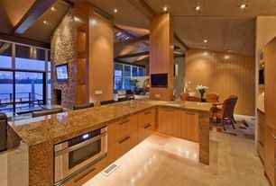 Modern Kitchen with specialty window, Fireplace, Columns, Breakfast bar, GE Single Wall Oven, Simple granite counters, Paint