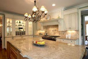 Traditional Kitchen with Standard height, Built-in bookshelf, Chandelier, Crown molding, can lights, Hardwood floors