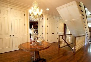 Traditional Hallway with Standard height, Wainscotting, Crown molding, Laminate floors, Chair rail, can lights, Chandelier