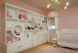 Contemporary Kids Bedroom with Dresser, Bubble chandelier, Built-in bookshelf, Crib, Area rug, specialty window, Wallpaper
