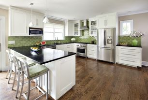 Traditional Kitchen with built-in microwave, Standard height, Soapstone counters, Green polished glass wall tile, gas range