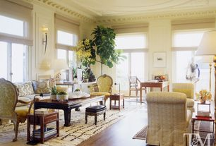 Traditional Living Room with High ceiling, Wall sconce, Hardwood floors, Crown molding, Transom window, French doors