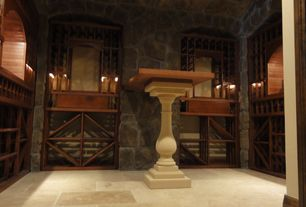Craftsman Wine Cellar with High ceiling, limestone floors