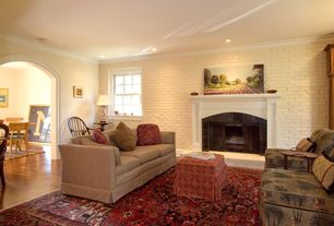 Eclectic Living Room with Laminate floors, Standard height, brick fireplace, Fireplace, double-hung window, can lights