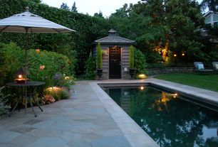 Traditional Swimming Pool with exterior stone floors, Pathway, Lap pool, Premium sunbrella round umbrella - milano stripe