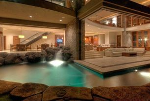 Contemporary Swimming Pool with Pool with waterfall, Indoor/outdoor living, Natural rock pool accents, West maui, hawaii