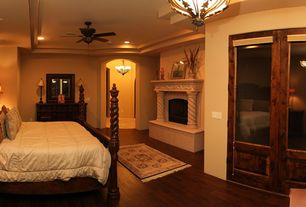 Traditional Master Bedroom with Hardwood floors, Cement fireplace, Pendant light, Ceiling fan