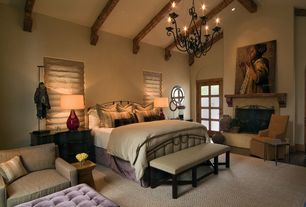 Mediterranean Master Bedroom with specialty window, Fireplace, French doors, High ceiling, Exposed beam, Cement fireplace