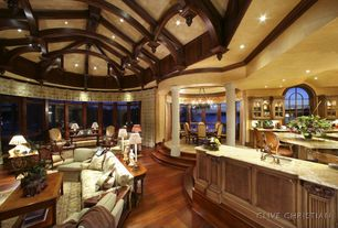 Contemporary Kitchen with Breakfast bar, Chandelier, Undermount sink, can lights, Glass panel, Exposed beam, Columns