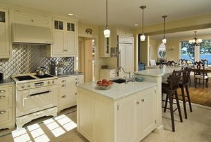 Traditional Kitchen with Custom hood, Frigo quilted stainless-steel backsplash, Glass panel, Breakfast bar, Kitchen island