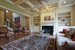 Contemporary Living Room with Hardwood floors, Ceiling fan, Fireplace, Standard height, insert fireplace, Box ceiling