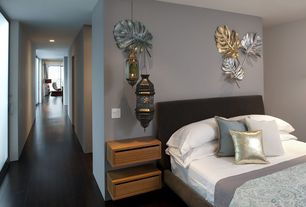 Contemporary Guest Bedroom with Laminate floors, Pendant light