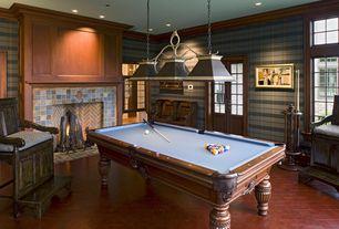 Craftsman Game Room with Casement, Fireplace, interior wallpaper, Glass panel door, Pendant light, brick fireplace