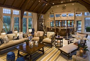 Eclectic Great Room with Cathedral ceiling, French doors, Pendant light, Transom window, Exposed beam, Wall sconce