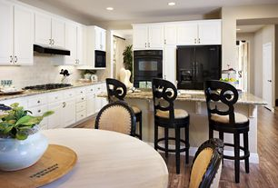 Traditional Kitchen with Simple granite counters, built-in microwave, Wall Hood, full backsplash, can lights, six panel door