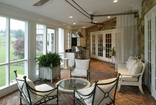 Contemporary Porch with French doors, exterior brick floors, Outdoor kitchen, Screened porch