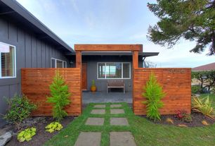 Contemporary Landscape/Yard with picture window, six panel door, Pathway