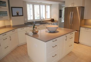 Contemporary Kitchen with Corian-solid surface countertop in dove
