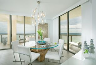 Contemporary Dining Room with Laminate floors, Pendant light, Balcony