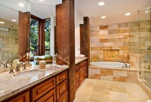 Mediterranean Master Bathroom with frameless showerdoor, Complex granite counters, Inset cabinets, Double sink, Raised panel