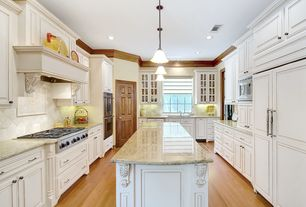 Traditional Kitchen with Pendant light, Custom hood, Undermount sink, Large Ceramic Tile, Raised panel, Crown molding