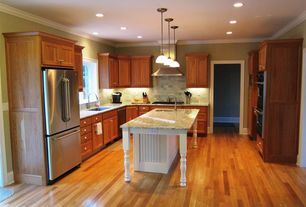 Traditional Kitchen with Sandstone Tile, Stone Tile, Kitchen island, Flat panel cabinets, Hardwood floors, Undermount sink