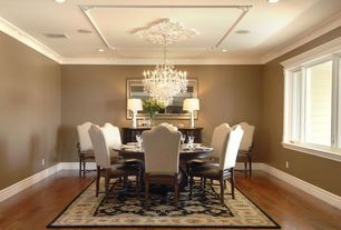Traditional Dining Room with can lights, Plaque ceiling mold, Paint, Agatha pedestal dining table, Chandelier, Crown molding