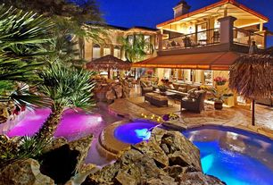 Tropical Swimming Pool with Outdoor living room, Natural rock pool accents, Deck Railing, Pool with hot tub, exterior awning