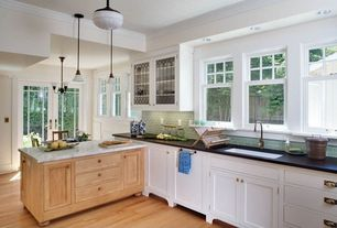 Country Kitchen with Simple granite counters, Pendant light, Glass panel, Undermount sink, Crown molding, Inset cabinets