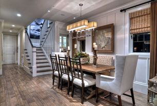 Contemporary Dining Room with Wainscotting, Chandelier, Crown molding, Hardwood floors, specialty door