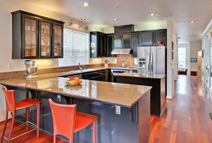 Contemporary Kitchen with electric cooktop, Breakfast bar, can lights, wall oven, Framed Partial Panel, Silestone, Casement