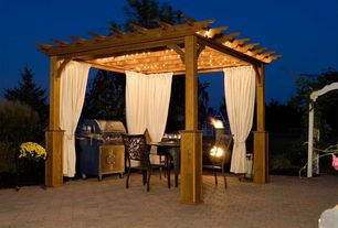 Traditional Patio with Trellis, Outdoor curtains, Outdoor dining area, Gazebo, Chiminea, Interlocking Pavers
