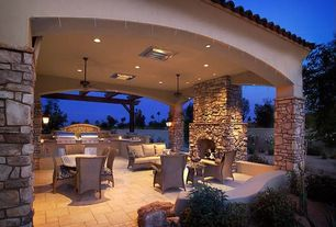 Mediterranean Patio with exterior stone floors, Outdoor kitchen, Fence, Pathway, Trellis, Eldorado stone country rubble