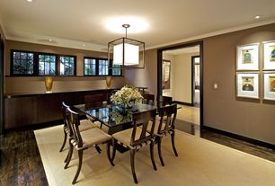 Contemporary Dining Room with Hardwood floors, flush light, Crown molding