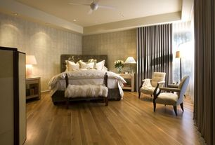 Contemporary Master Bedroom with Laminate floors, Ceiling fan, interior wallpaper