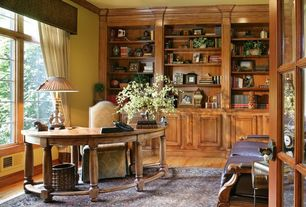 Traditional Home Office with French doors, Crown molding, Built-in bookshelf, specialty window, Standard height