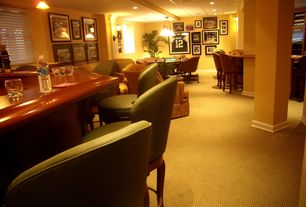 Traditional Basement with can lights, Leather bar stool, Crown molding, Columns, Wall sconce, Carpet, Standard height