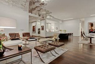 Contemporary Great Room with Open concept, Tufted full leather modern chair, Barcelona ottoman, White area rug