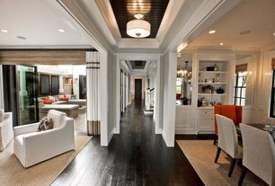 Contemporary Hallway with Hardwood floors, High ceiling, flush light, Crown molding