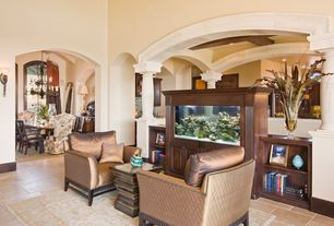 Traditional Living Room with limestone tile floors, Built-in bookshelf, High ceiling, Columns