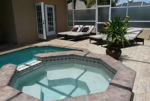 Tropical Hot Tub with Pool with hot tub, exterior stone floors, French doors